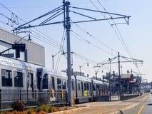 Guld- linje för tunnelbana längs den första gatan i östliga Los Angeles royaltyfria foton
