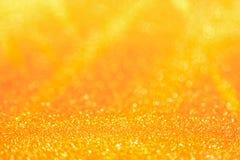 Guld- ljus av guld- bokehbakgrund Guld- himmelljus Ho Arkivbilder