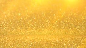 Guld- ljus av guld- bokehbakgrund Guld- himmelljus Ho Fotografering för Bildbyråer