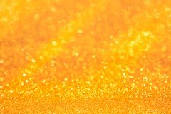 Guld- ljus av guld- bokehbakgrund Guld- himmelljus Ho Arkivfoto