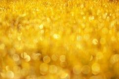 Guld- ljus och bokehtextur Arkivbild