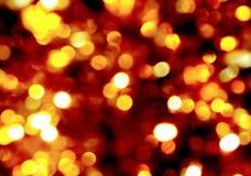 Guld- ljus på mörk bakgrund, suddiga cirklar för bakgrund för bokeh gula och vita, ferie, glöd, ljus arkivbild