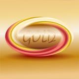 Guld- logo på en beige bakgrund Royaltyfri Fotografi