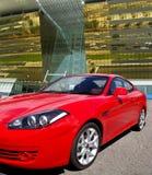 guld- lyxigt modernt för bakgrundsbyggnadsbil Fotografering för Bildbyråer