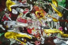 Guld- målarfärg för silver, skuggor på livlig abstrakt bakgrund Arkivbild