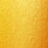 Guld- målarfärg på cementväggtextur guld- textur för bakgrund Royaltyfri Fotografi
