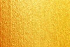 Guld- målarfärg på cementväggtextur guld- textur för bakgrund Arkivbild