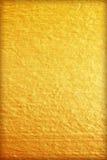 Guld- målarfärg på cementväggtextur guld- textur för bakgrund Arkivbilder