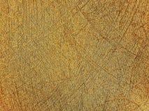 Guld- målningtexturbakgrund och texturbegrepp arkivfoton