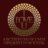 Guld mönstrade bokstäver med rankor Tappningromantikerstilsort Royaltyfri Bild