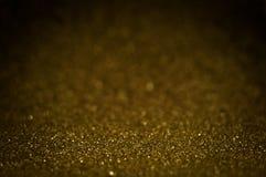 Guld- magiskt skinande blänker dekorativ textur, texturerat metalliskt Royaltyfria Bilder