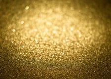 Guld- magiskt skinande blänker dekorativ textur, texturerat metalliskt Arkivbild
