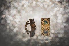 Guld- manschettknappar Arkivfoton
