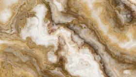 Guld- marmorbakgrund royaltyfria bilder