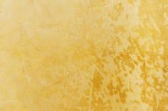 Guld- marmorbakgrund Arkivbilder