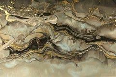 Guld- marmorera texturdesign Beige och guld- marmormodell Fluid konst royaltyfria bilder
