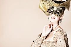 guld- maskering Arkivfoto