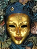 guld- maskering Arkivbild