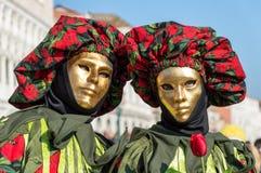 Guld- maskeringar för Venedig karneval Arkivfoto