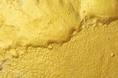 Guld- mellanrum för texturbakgrundsabstrakt begrepp för design arkivfoton