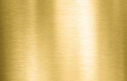 Guld- metall borstad bakgrund eller textur arkivbild