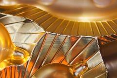 Guld- metallbakgrund för abstrakt sken med linjer Royaltyfria Foton