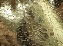 Guld- metallisk textilnärbild Royaltyfri Bild