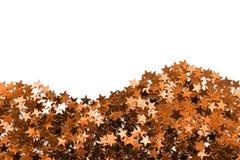 Guld- metalliska konfettier Royaltyfri Bild