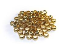 Guld- metallpärlor Fotografering för Bildbyråer