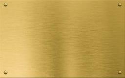 Guld- metallplatta eller nameboard med nitar arkivfoto