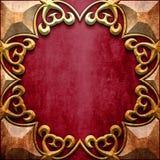 Guld- metallram på röd metall Arkivfoton