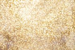 Guld- mousserande bakgrund med kopieringsutrymme Arkivfoton
