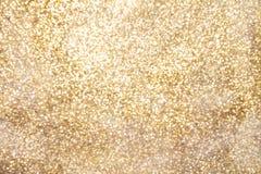 Guld- mousserande bakgrund med kopieringsutrymme Arkivfoto