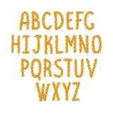 Guld mousserar alfabetet, abc Arkivfoto