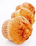 guld- muffiner Royaltyfria Bilder