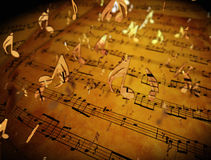 guld- musikaliska anmärkningar Arkivbild