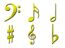 Guld- musikaliska symboler arkivbilder