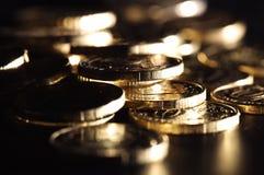 Guld- mynt Fotografering för Bildbyråer