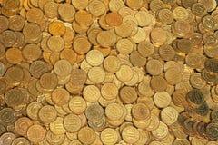 Guld- mynt Arkivfoto
