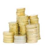 Guld- mynt i buntar royaltyfria bilder