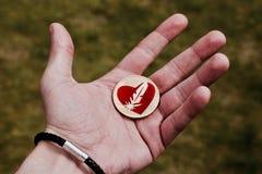 Guld- mynt med hjärta Fotografering för Bildbyråer