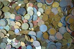 Guld- mynt och gammalt mynt Arkivfoto