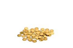 Guld- mynt på vit bakgrund, affärsbankrörelseidé arkivfoton
