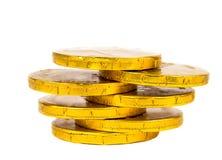 Guld- myntar isolerat Arkivfoto