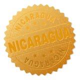 Guld- NICARAGUA medaljstämpel stock illustrationer