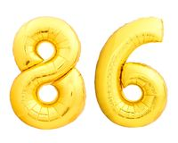 Guld- nummer 86 åttiosex gjorde av den uppblåsbara ballongen Arkivfoton