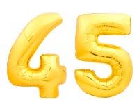 Guld- nummer 45 fyrtiofem gjorde av den uppblåsbara ballongen på vit Arkivbilder