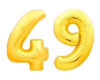 Guld- nummer 49 fyrtionio gjorde av den uppblåsbara ballongen på vit Royaltyfria Foton