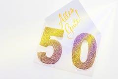 Guld- nummer 50 på räkningen med tysk text all bästa Arkivbilder