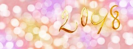 2018 guld- nummer, semestrar färgrik bakgrund med suddiga ljus Arkivfoto